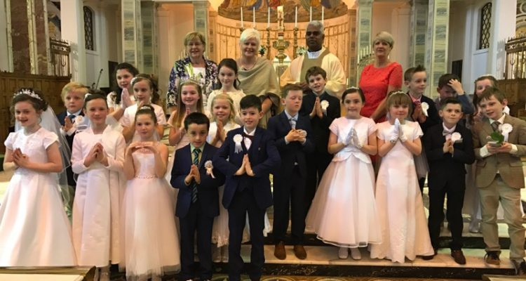 COTE Adorer's receive their 1st Holy Communion